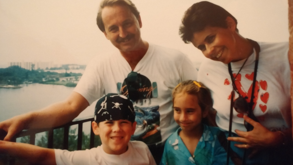 At the top of the lighthouse with my dad, cousin, and mom in the mid-1990s. As you can tell from my expression, I wasn't so sure if I was enjoying the experience.
